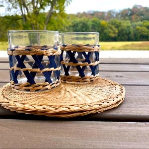 Two glasses with rattan embellishment.
